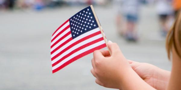 Girl holding the American flag