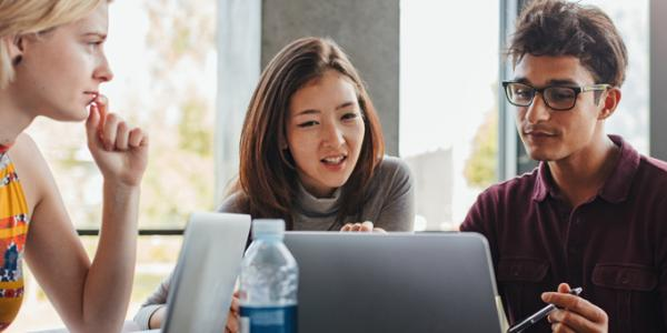 College students gathered around a computer screen
