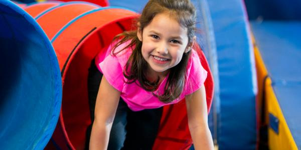 Young girl smiling during play
