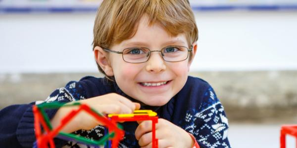Boy building with K'NEX