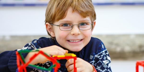 Boy building with K'NEX