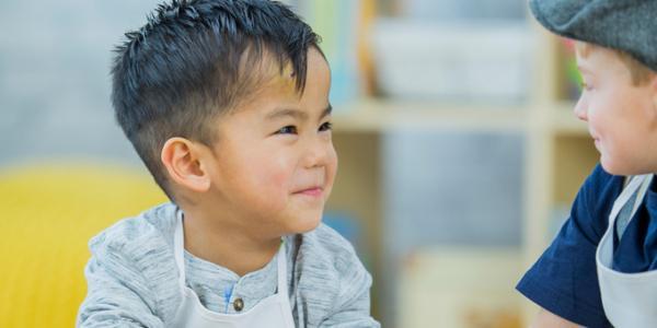 Two preschool boys smiling