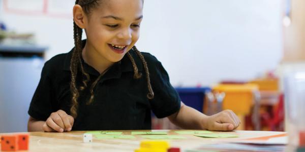 Child enjoying math activities.