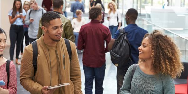 Adult students walking down hallway