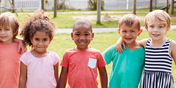 Children standing outdoors.