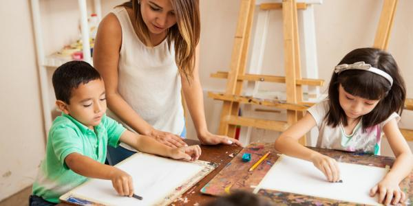 Children drawing in an art studio