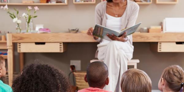 Teacher reading to preschool class