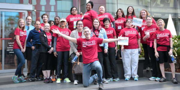 A group of professionals wearing red Early Ed for America shirts