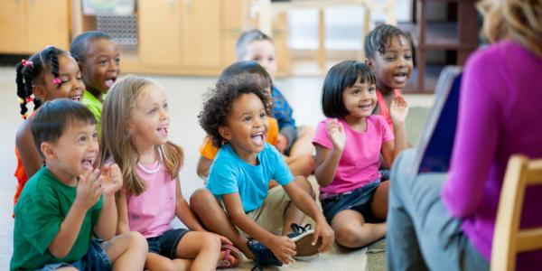 Children smiling and learning during circle time