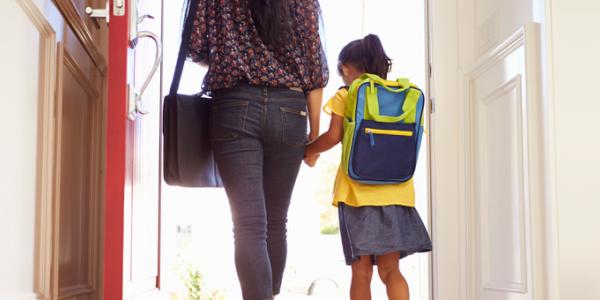 Mother taking her child to first day of preschool