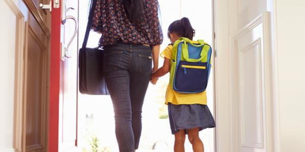Mother and daughter holding hands and walking.