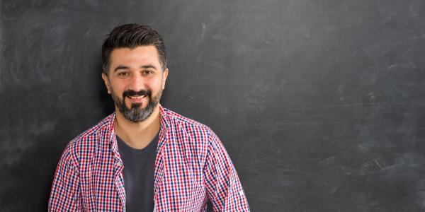 A teacher at a chalkboard