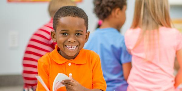 A young boy enjoying a book