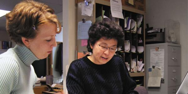 Two women looking at paperwork together