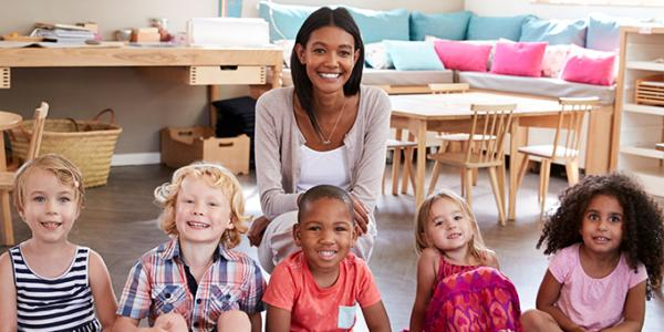 Group photo of preschool teacher and class