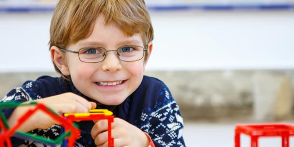 Boy building a structure with toys