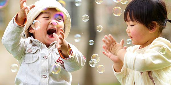 Two babies with bubbles.