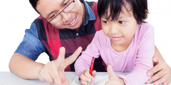 Father shows child the letter v.