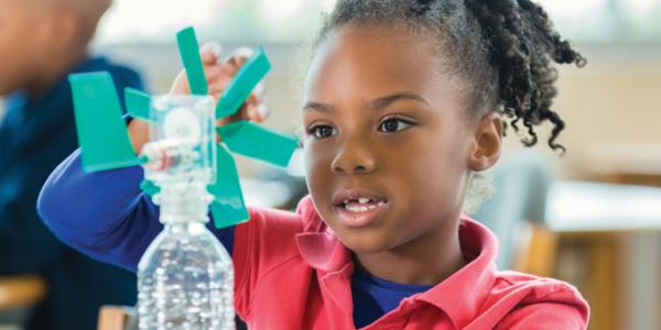 young girl doing a creative science experiment
