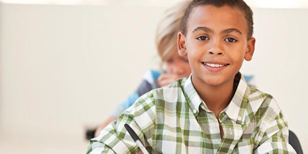 elementary school boy writing