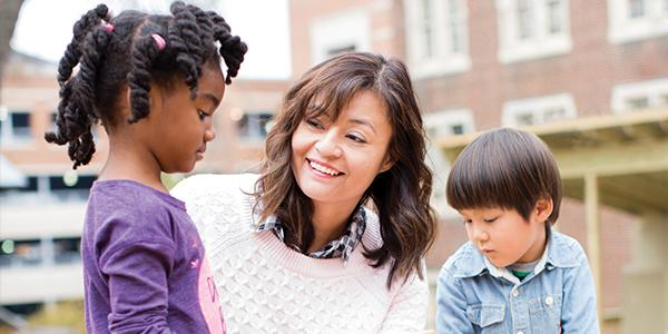 teacher speaks with students