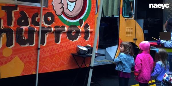 Preschoolers standing at taco truck