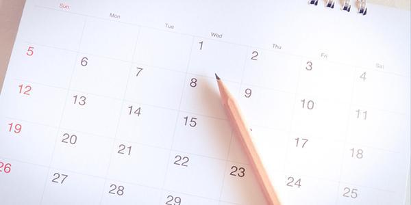 A paper calendar and a pencil
