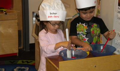 children play baking in classroom