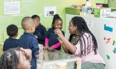 Teacher smiling with her preschool class