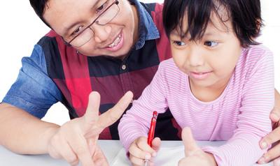 Father and daughter engaging in learning
