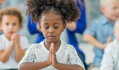 Young girl meditates