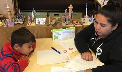 Nadia Jaboneta working with a boy at a desk