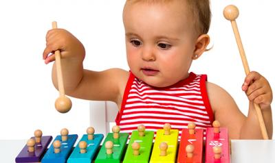 Toddler playing with a music toy.