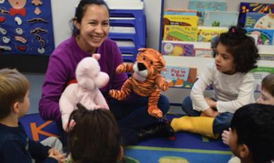 Teacher playing with stuffed animals during circle time