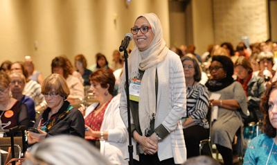 Woman asking a question at a workshop.