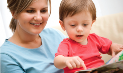 Mom reading a book with her toddler