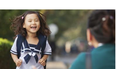 Early childhood girl smiling as she greets someone