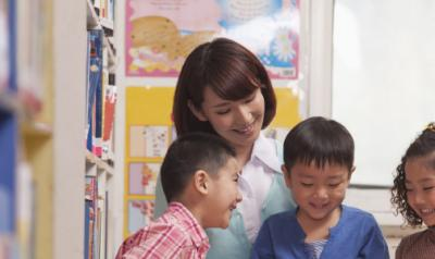 Teacher with early childhood students