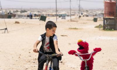 boy with Elmo in Syria