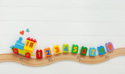 a toy train with numbers on it