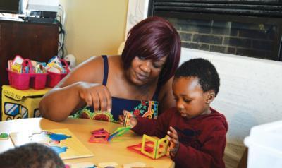 Teacher helping student build structure
