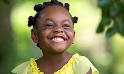Preschool girl smiling outside