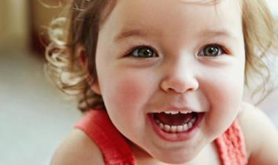 Toddler girl laughing