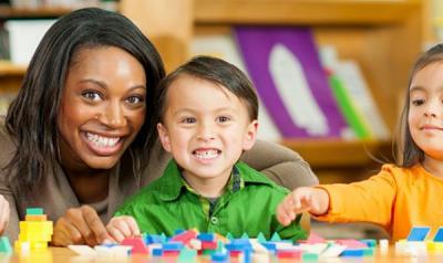 Teacher and preschooler counting blocks