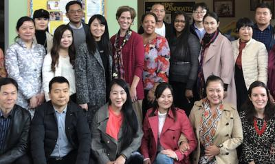 Cotrainers Dr. Nili Luo and Dr. Lea Ann Christenson with a group of teachers, directors, and investors from China