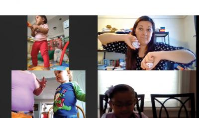 a screenshot of a video call with teachers and children dancing with each other