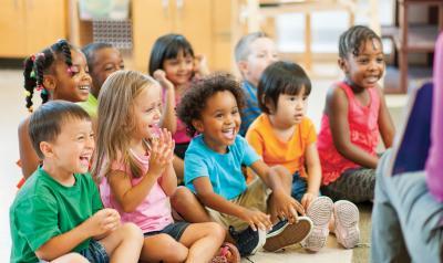 Preschool students sitting on floor