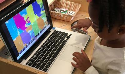 Student looking at warhol effect on laptop