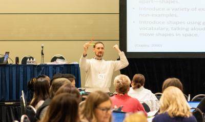 NAEYC conference presenter conducting a session.