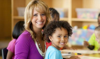 Teacher sitting with preschooler